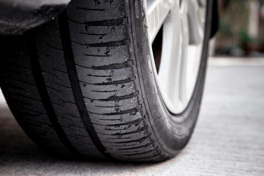 Car tyre showing signs of tyre wear.