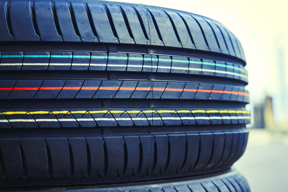 New car tyres stacked on top of one another.
