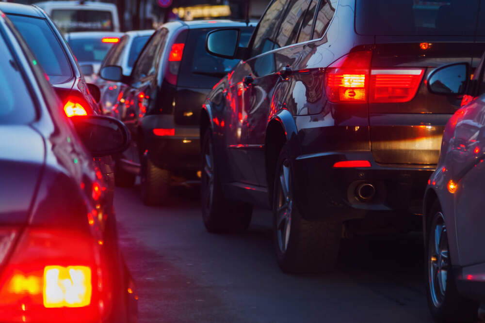Vehicles in traffic with their brake lights on.