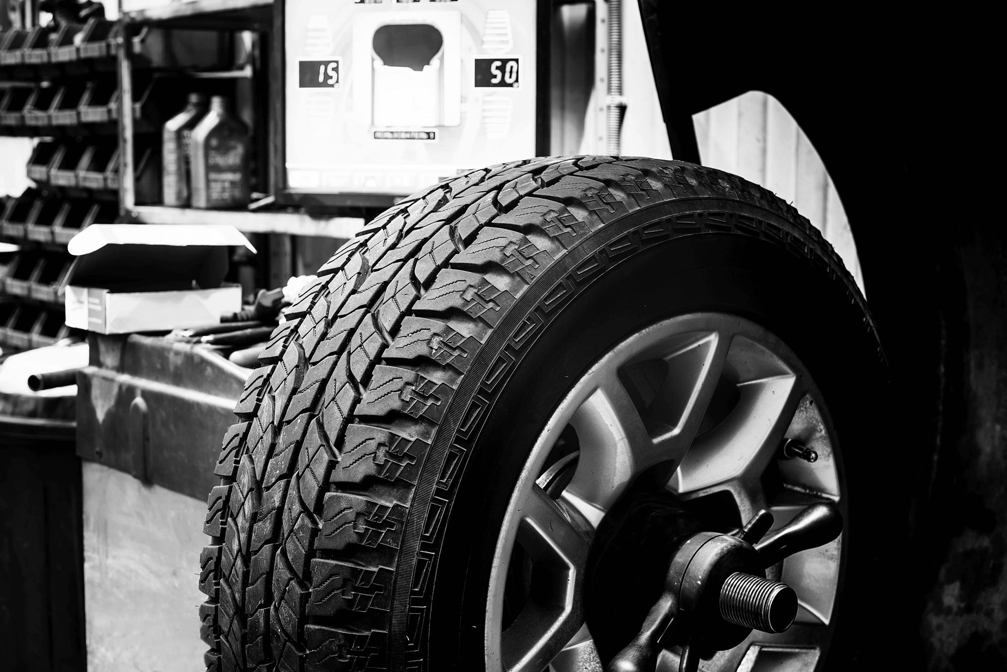 All terrain tyre mounted on balancing machine