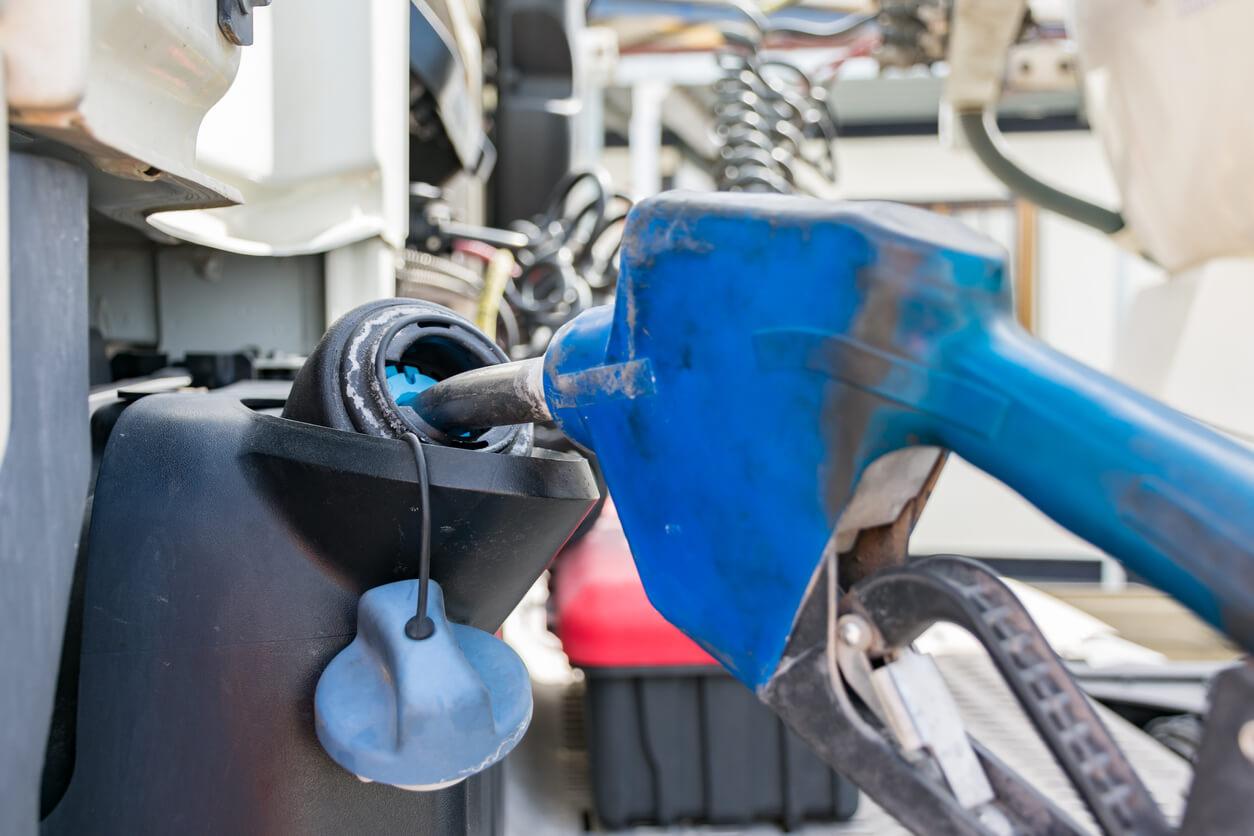 Blue coloured diesel exhaust fluid nozzle