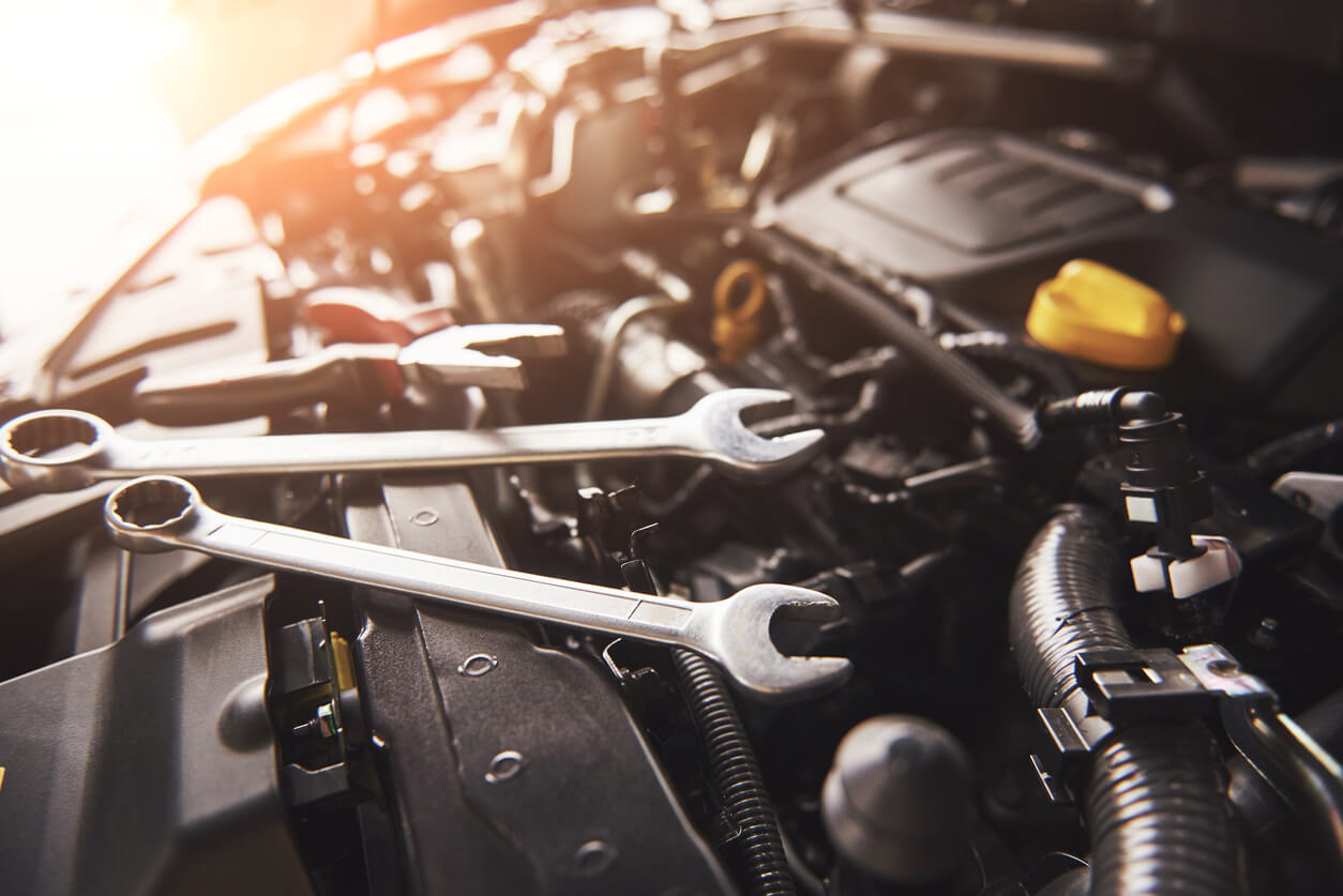 Spanners and other tools placed in the engine compartment of a vehicle being serviced