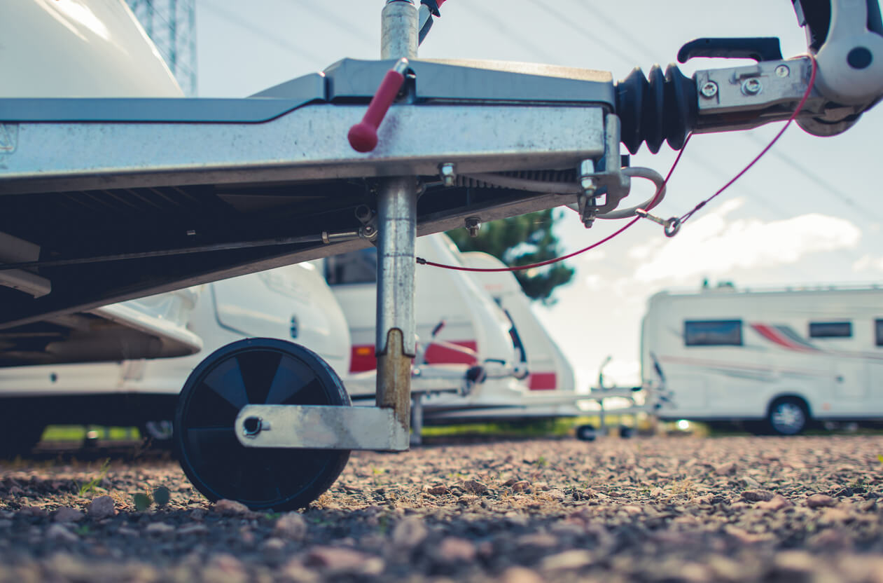 Low angle shot showing caravan dolly wheel and trailer hitch