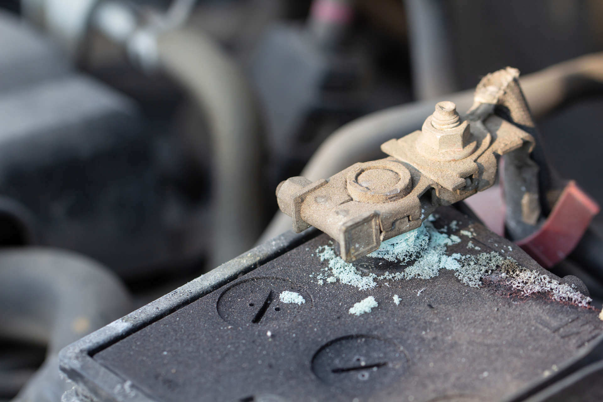 Corroded battery terminal in car. Showing old and damaged car battery.