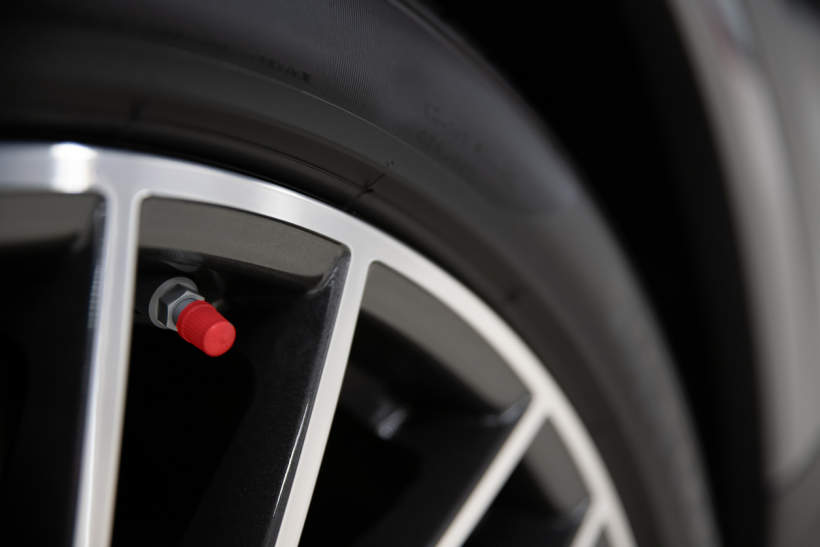 In Australia, a red valve cap indicates the tyre has been inflated with nitrogen gas rather than air