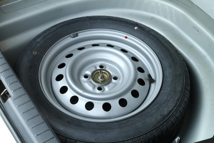 Spare tyre in boot of car