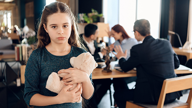 Small girl holds a teddy bear. Picture: shuttershock
