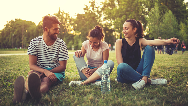 Three beautiful friends sitting in the park,laughing and having a great time. Picture: iStock