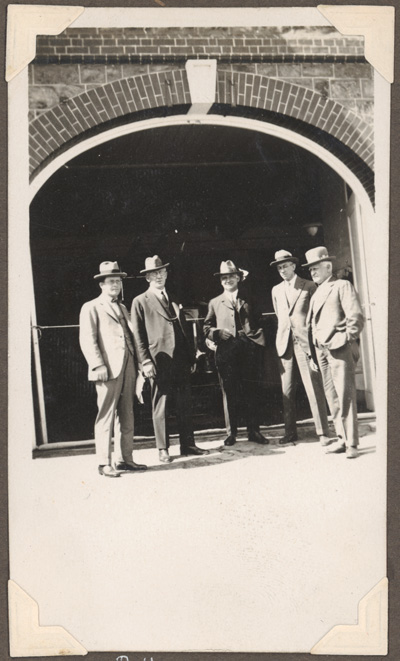 B.H [Broken Hill 5 men standing in front of an arch]