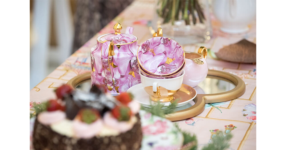 Pink festive teapots and chinaware
