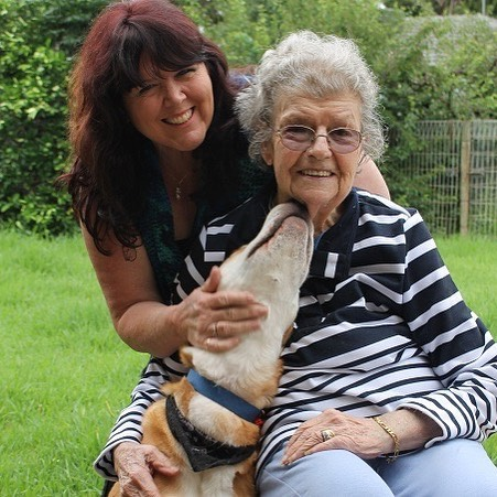 Aged Care Worker with Elderly lady and happy dog