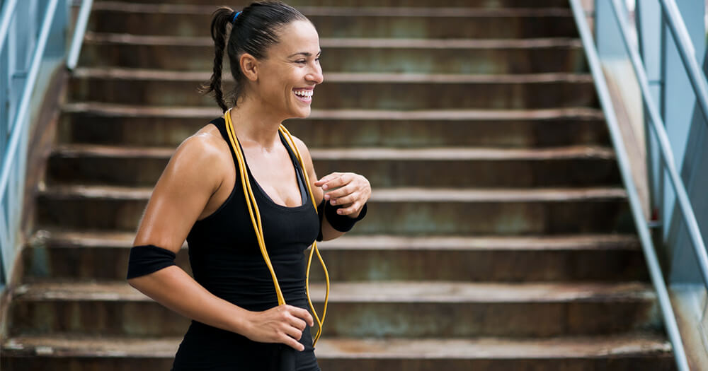 Woman completing big goals in fitness, stairs