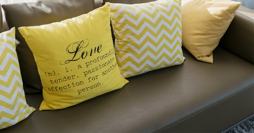 Yellow chevron print cushions and cheesy quote on cushion