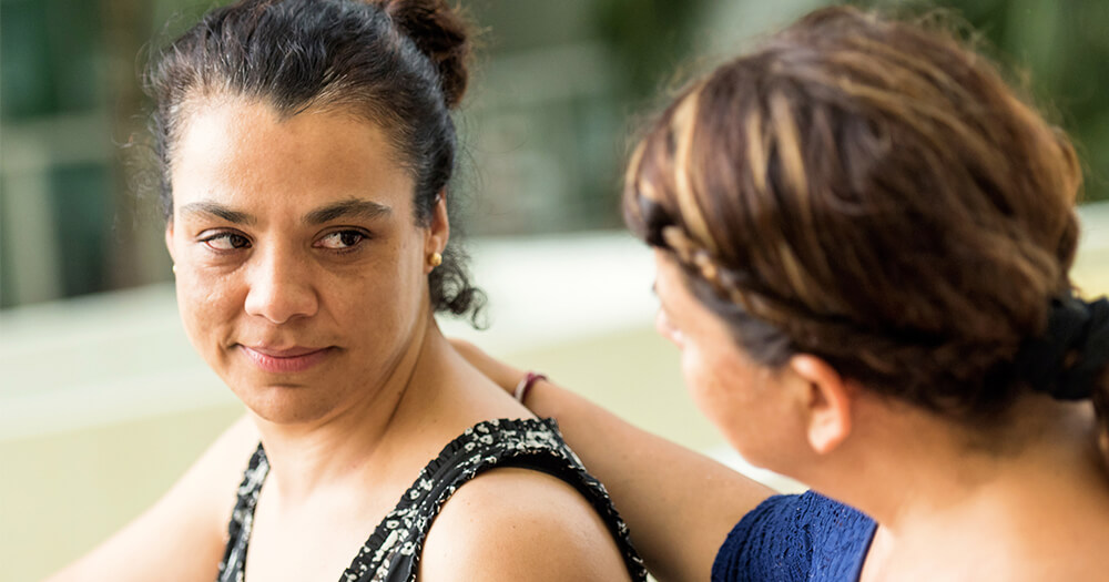 AOD Support worker comforting, supporting and helping her client recover from addicition