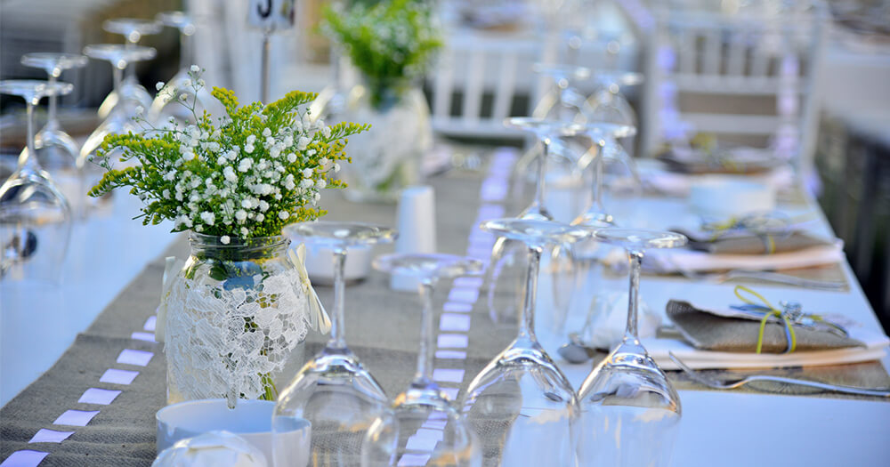 Beautiful venue for a wedding with decorations, flowers, table setting