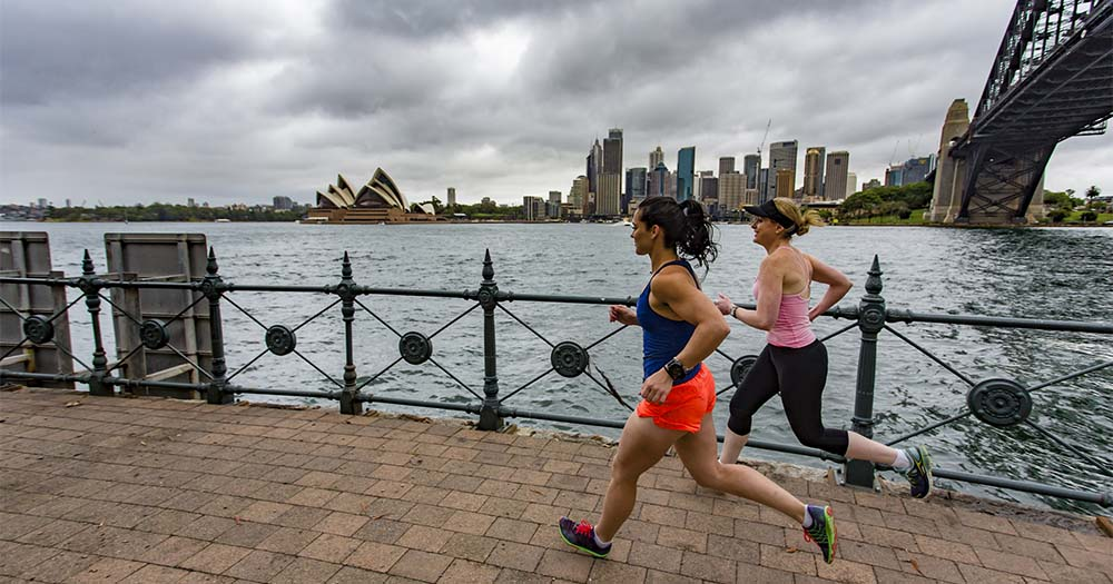 Two ladies taking a morning run in Circular Qua with a view of the Sydney Opera House