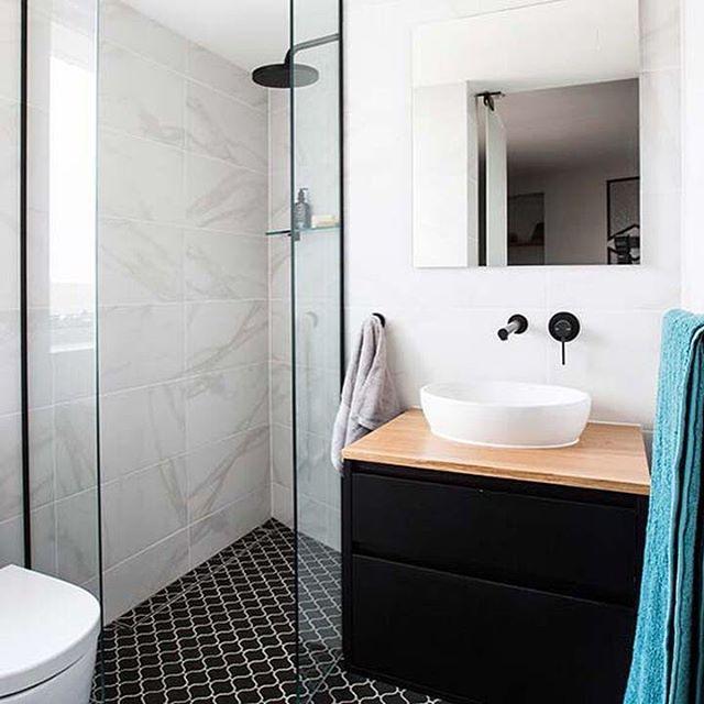 Black mosaic tile in bathroom