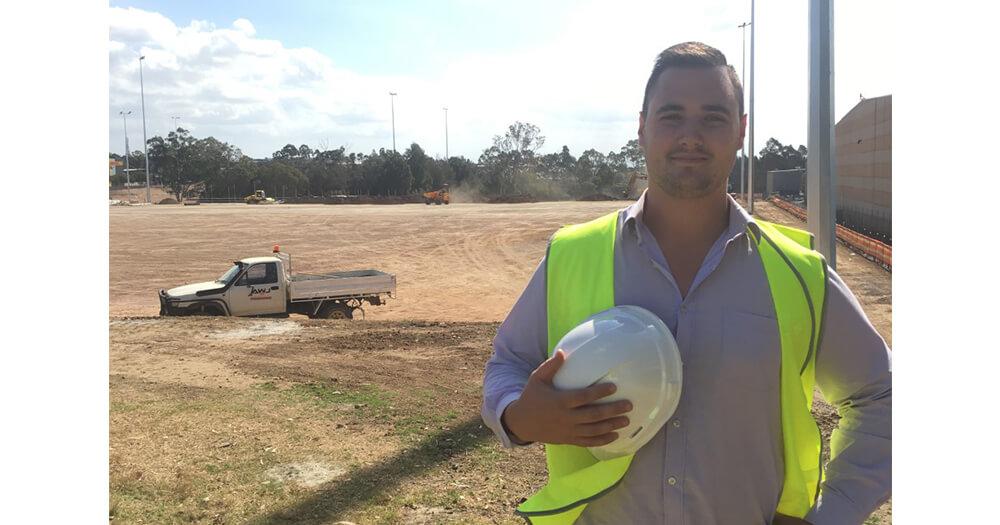 Hayden Jones is a construction worker in high vis who has begun his construction training