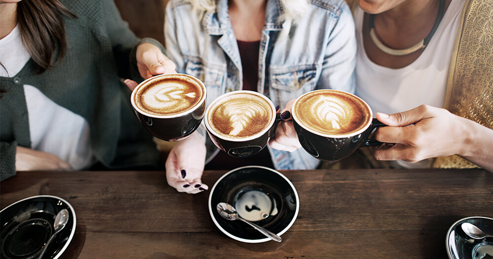 Group of girlfriends enjoying the health benefits of coffee