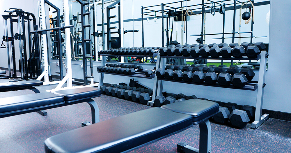 Empty fit and healthy hotel gym room with modern equipment