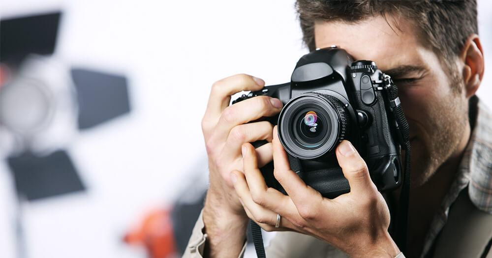 Photographer man with big camera
