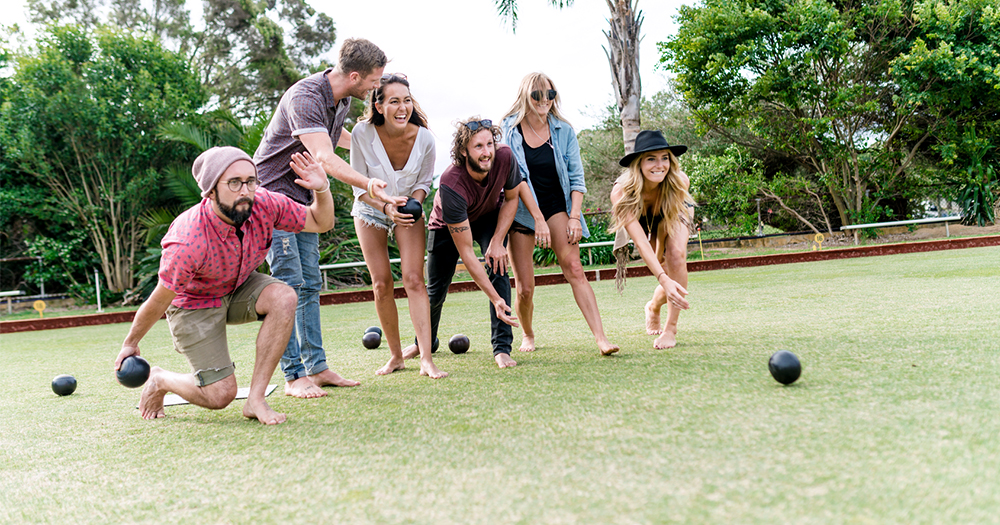 Lawn bowls social events with young group of people