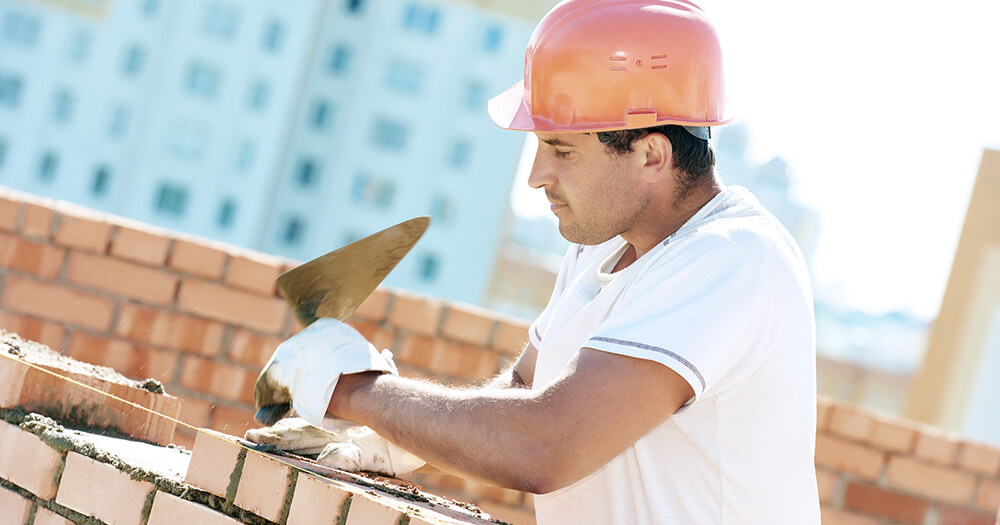 bricklayer with white card