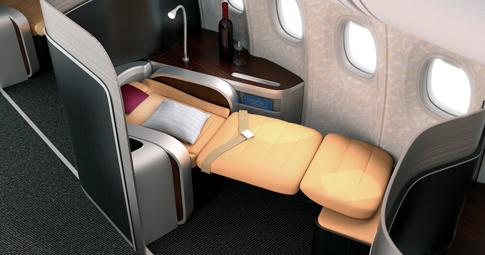 First class and business class flat bed area with side table and wine on plane