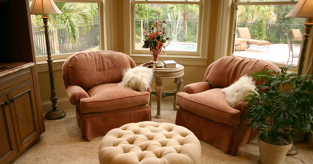 Cosy nook with two armchairs, side table and pouf