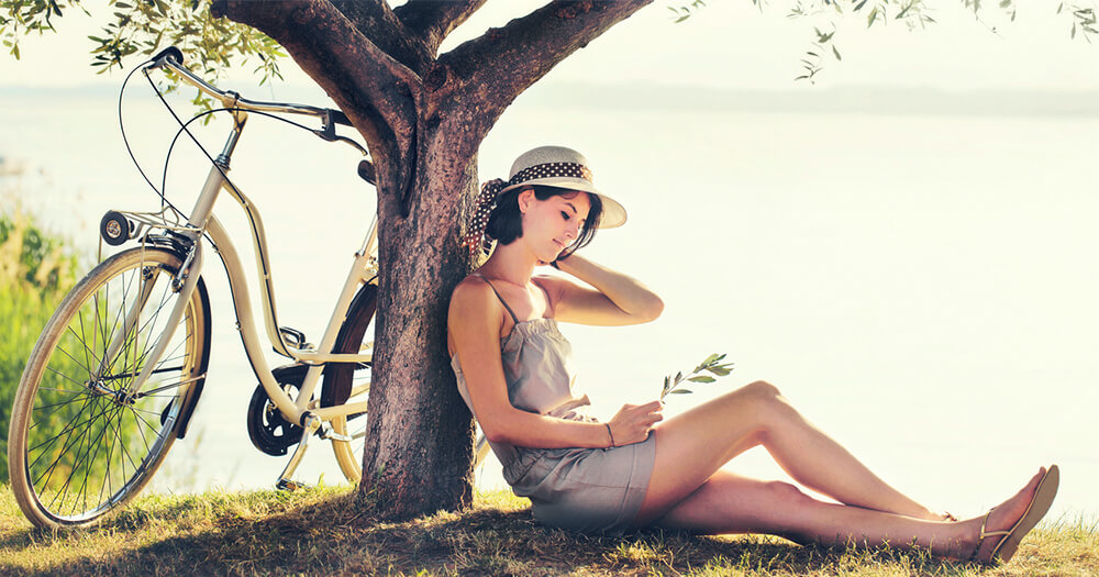 How to look after yourself in the wellbeing industry, peaceful scene with girl and bicycle