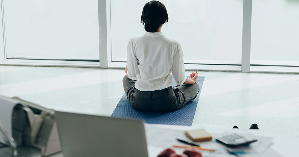 Lady meditating in office space