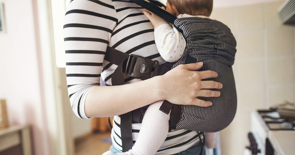 Mother using baby carrier