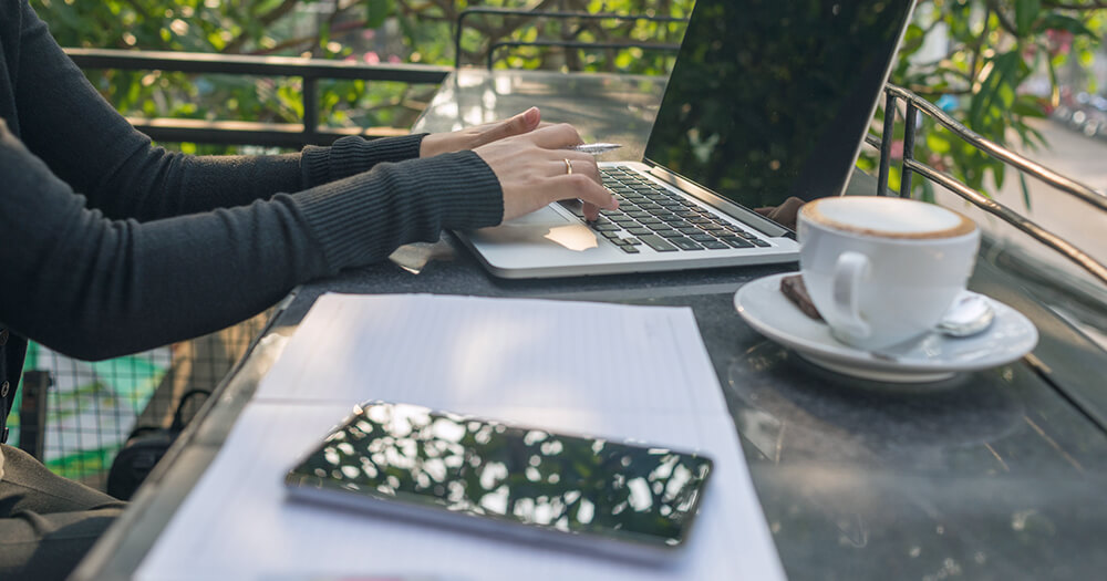 Studying online outdoors with a coffee
