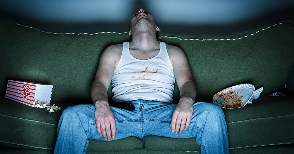 Man Procrastinating His Health and Fitness Goals