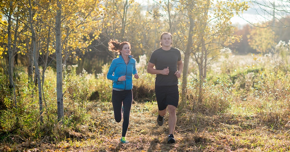 Health and Fitness Goals - Couple Running In Park