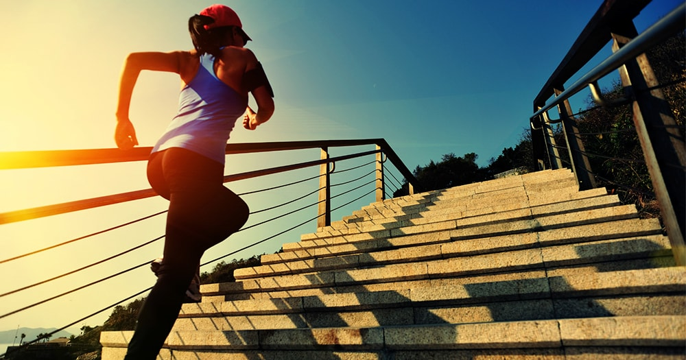 Health and Fitness Goals - Women Running Up Stairs