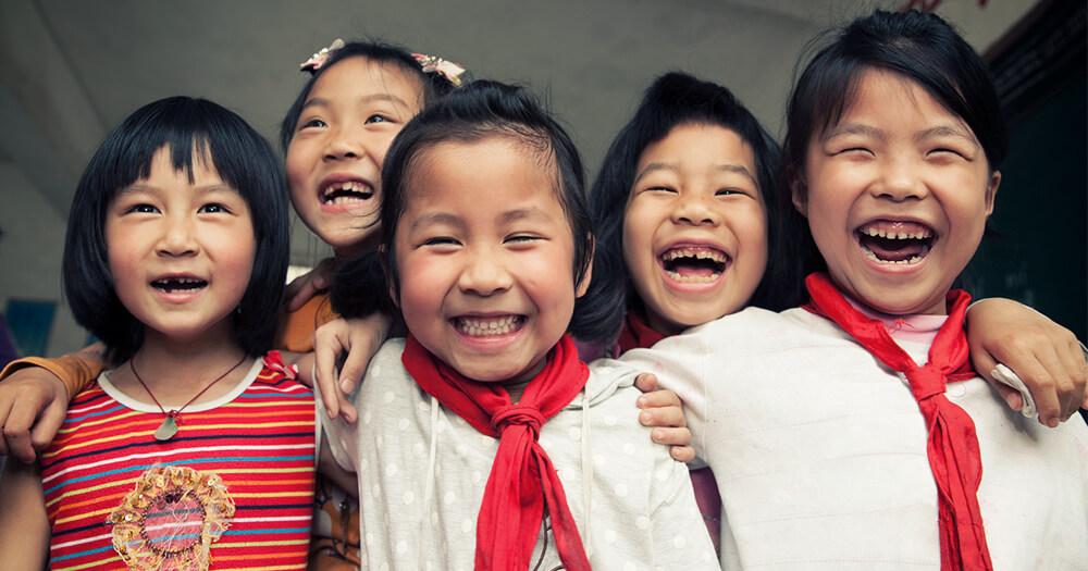 Smiling happy Asian school children