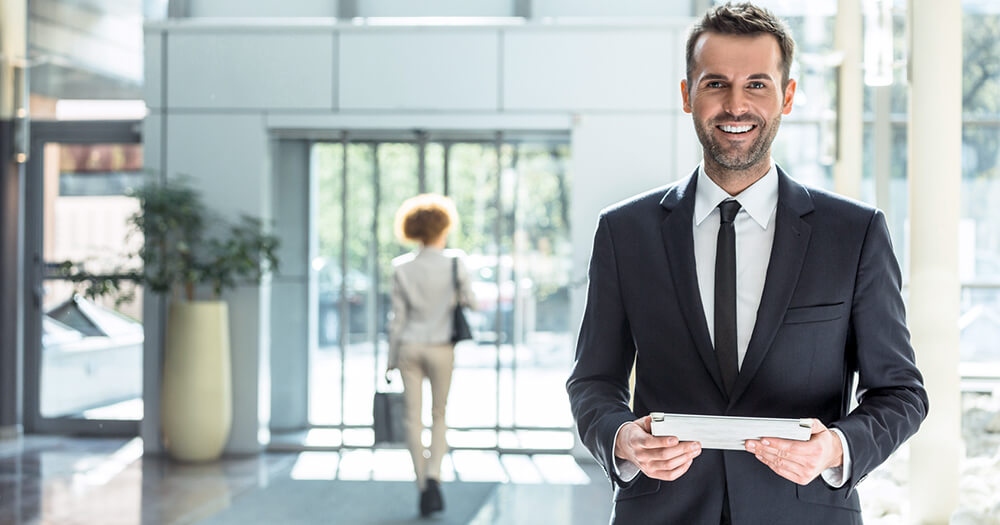 Front of house manager, male in suit in lobby