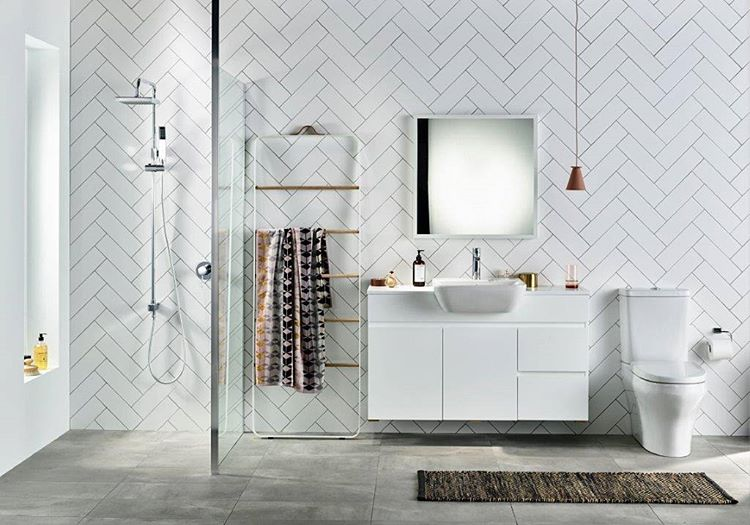 White subway tiles in a herringbone pattern