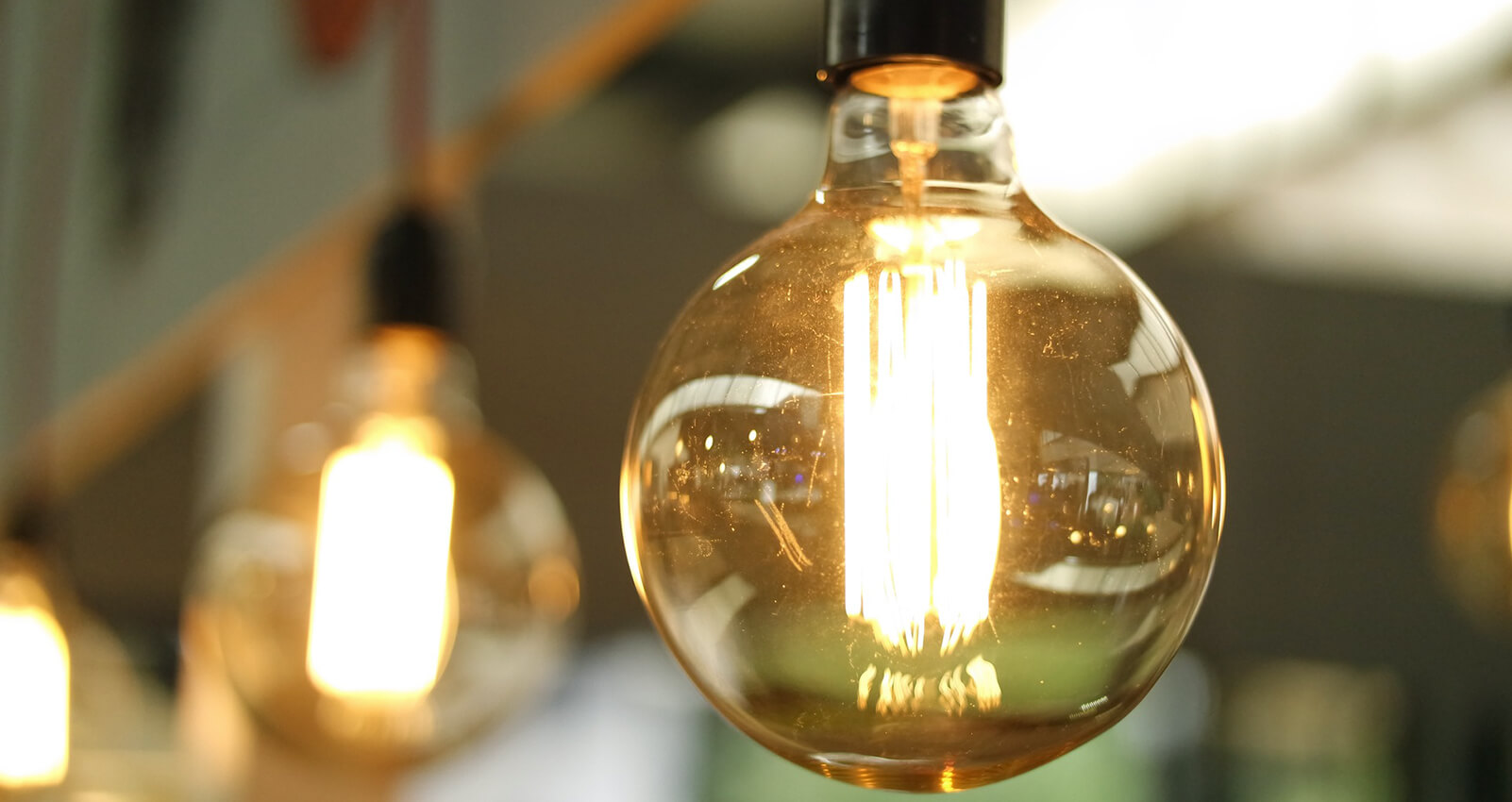 Lightbulb moment - ideas, invention and evolution concept - close up of light fixture