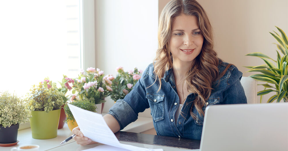 Lady in denim shirt, returning to study at home office