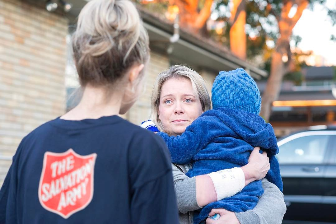 Salvation Army Australia community services worker, helping client with baby