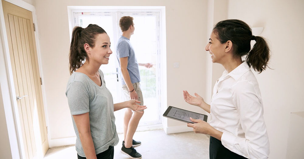 Female Australian Real Estate Industry professional at house inspection