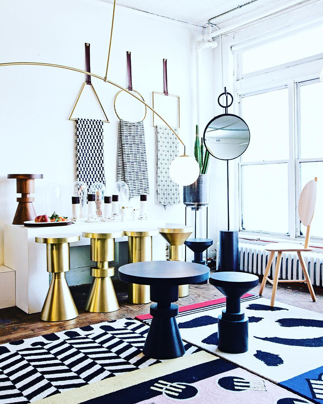 Bold geometric carpets, furnishings and stools