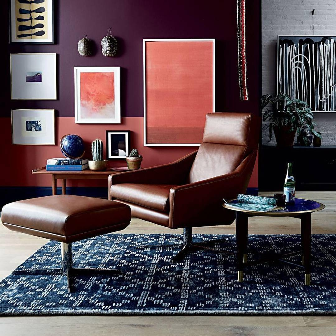 West Elm rug, swivel chair and foot stool with scarlet walls