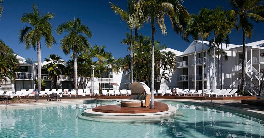 QT Port Douglas pool, hotel, deck chairs
