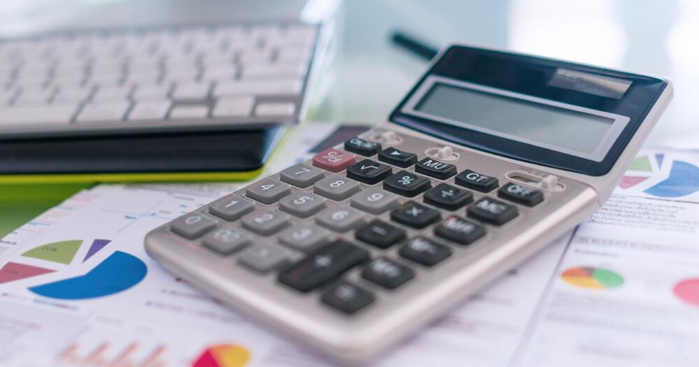 Calculator, sheets of data and graphs and keyboard