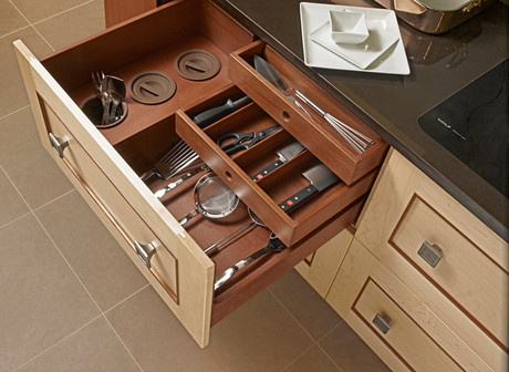 Three-layered wooden kitchen cabinet with three container perfect for organizing the kitchen utensils.
