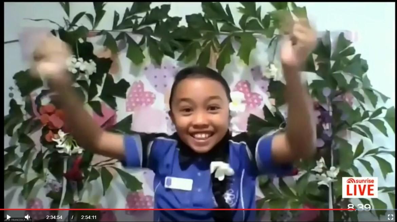 Francesca Hilario jumping for joy after winning the national junior virtual quiz!