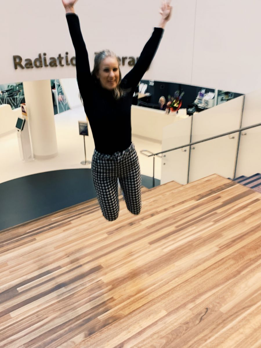 Maddie jumping for joy after finishing radiation